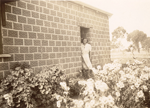 Grandmother at back door of country home, curca 1935